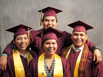 ASU American Indian graduates in cap and gown